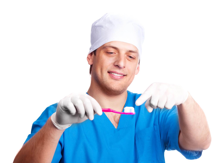 Guy holding toothbrush