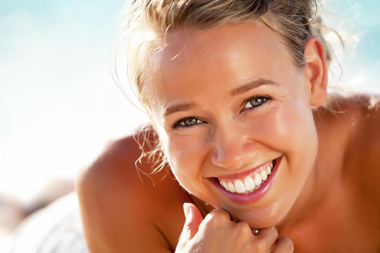 Woman showing her clean teeth