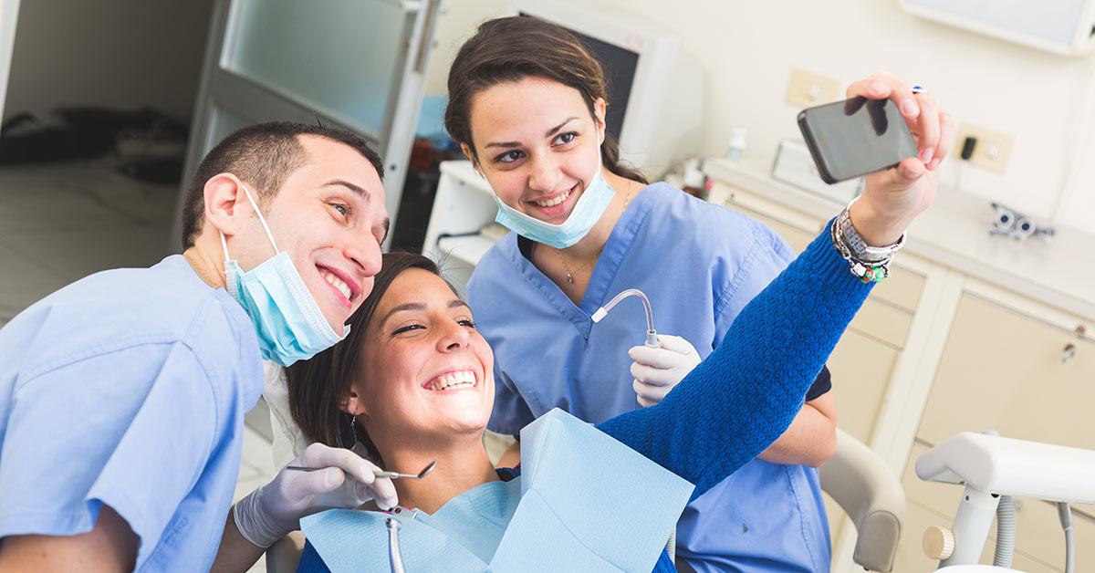 Dentist and customer having groupie