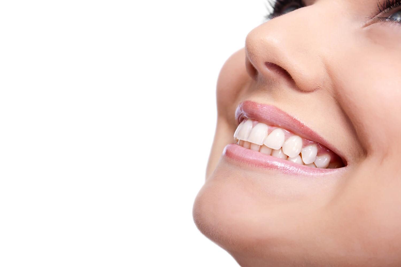 Woman showing her Cleang Teeth