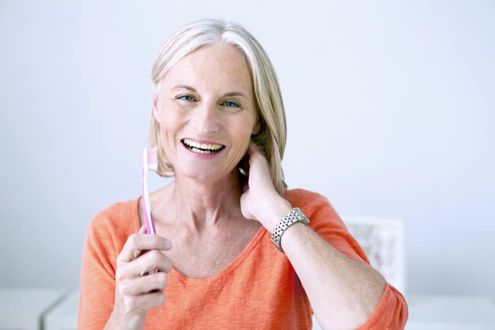 woman holding tootbrush
